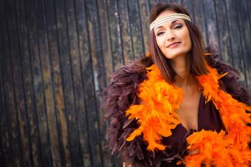girl in brown and orange boa