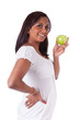 Young happy indian woman holding an apple