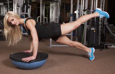 woman fitness gym leg up
