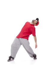 hip hop dancer performing move isolated over white background.