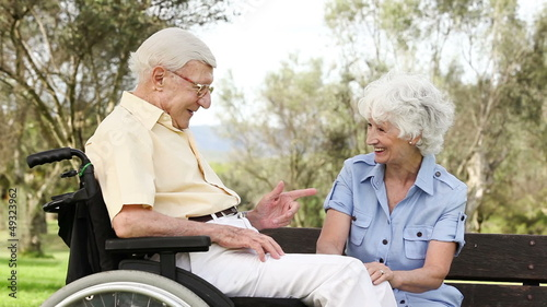 Old couple talking sitting