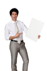 Elegant man pointing a blank square
