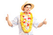 A smiling young guy in hawaiian costume giving thumbs up