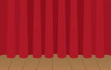 Red curtain closed on wooden stage