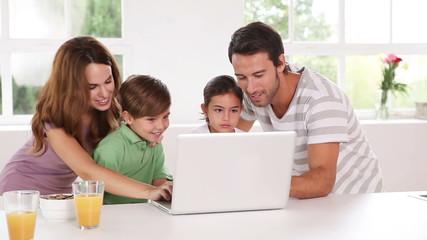 Family using a white laptop