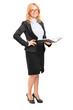 Full length portrait of a smiling female teacher holding a noteb