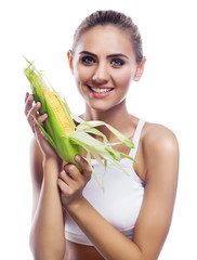 woman with corncob .  Concept vegetarian dieting - healthy food