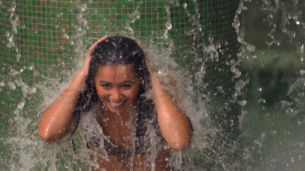 Woman taking a tropical shower