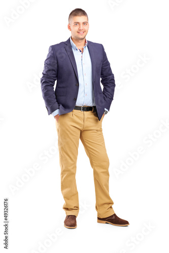 Full length portrait of a young handsome male posing