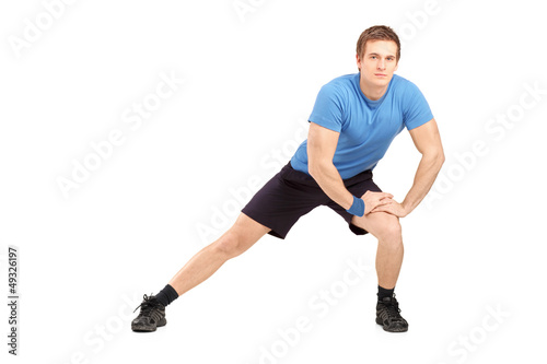 Full length portrait of a young maleathlete exercising
