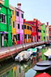 Colorful houses along a canal in Burano, near Venice, Italy