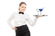 A waitress with bow tie holding a tray with two cocktails on it