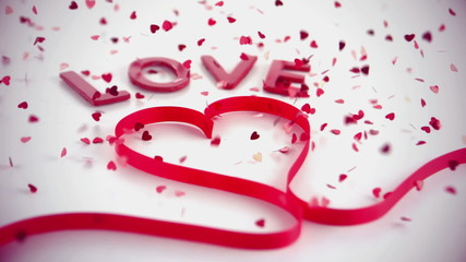Love text and heart ribbon with lots of confetti