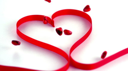 Red heart ribbon with confetti