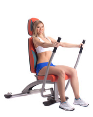 Blonde young woman on hydraulic exerciser