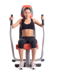 Brunette woman on orange  hydraulic exerciser