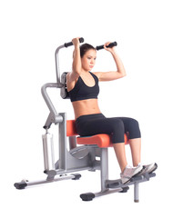 Young woman on orange  hydraulic exerciser
