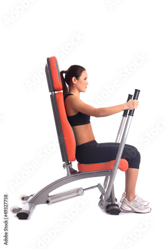 Brunette young woman on hydraulic exerciser