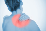 Woman rubbing highlighted shoulder pain