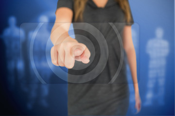 Businesswoman pressing on touchscreen
