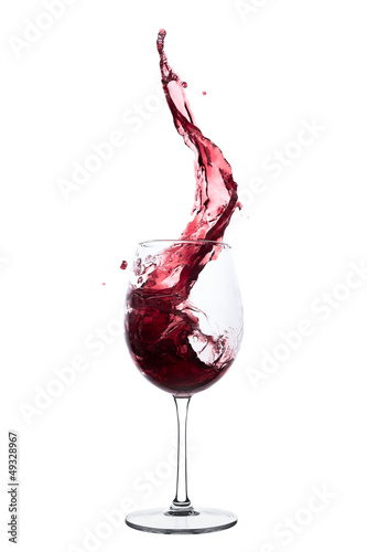red wine splashing out of a glass, isolated on white - 49328967
