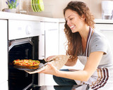 Fototapety Happy Young Woman Cooking Pizza at Home