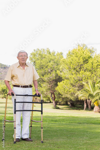 Portrait of elderly man using zimmer frame