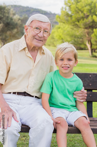 Portrait of grandfather and grandson in the park