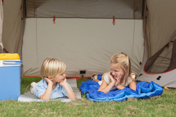 Brother and sister talking on the campsite