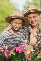 Mother and daughter gardening together portrait