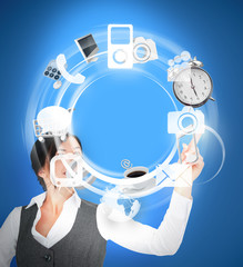 Wheel of various computer applications interface used by businesswoman