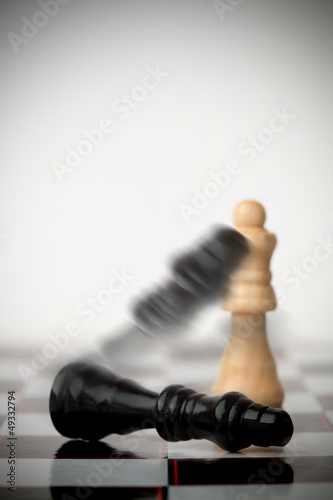 Chess pieces falling over
