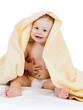 Adorable happy baby boy in towel