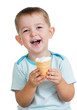 happy child boy eating ice cream in studio isolated
