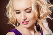 Closeup portrait of a pretty young and happy blonde woman