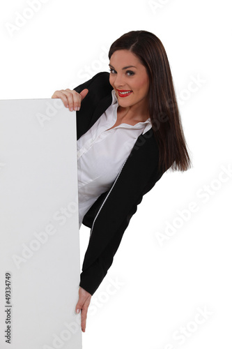 Attractive woman holding a blank sign