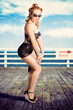 Cute Pinup Girl Looking Surprised On Beach Pier