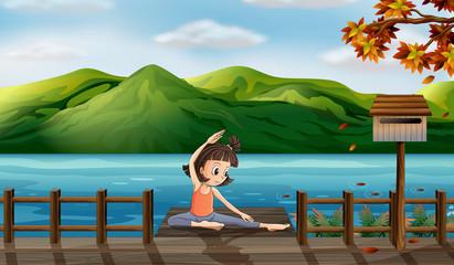 A girl excercising along the seaside