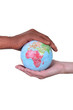 black and white hands holding globe
