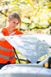 Young female driver wearing a high visibility vest/safety vest