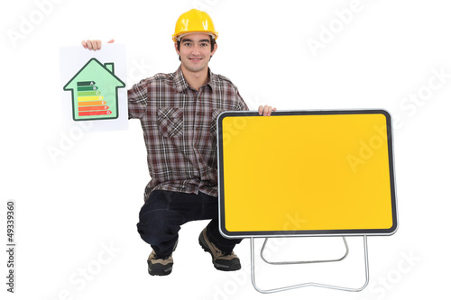 Man showing energy rating sign