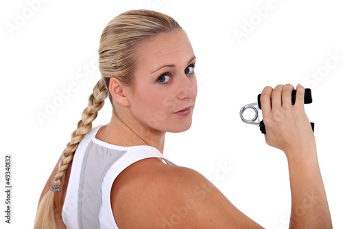 fit woman holding a gripper