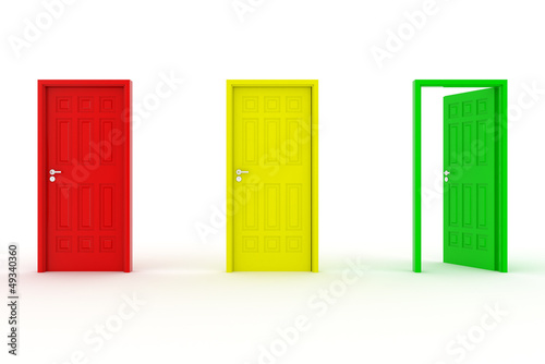 three doors in a a row - red, yellow, green - green door open