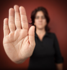 Woman with her hand extended signaling to stop