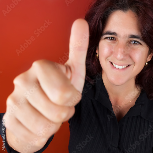 Beautiful hispanic woman doing the thumbs up sign