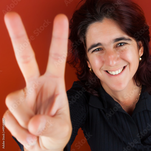 Hispanic woman doing the victory sign