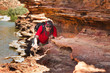 Man sneak along rock edge