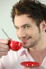 portrait of young man having cup of coffee