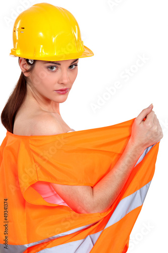 sexy female construction worker undressing