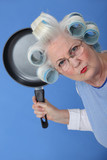 Angry old lady threatening to use frying pan
